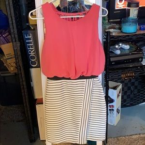 Coral dress, with striped pencil bottom.